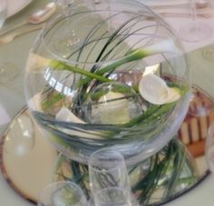 Less is more with this stylish yet simple centerpiece. Once lit the candle reflects gorgeous light into the glass vase and the mirror below.