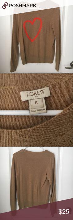 J Crew camel heart sweater Size small J Crew Camel heart sweater. Heart is an orange pink. 28% wool. Lightly worn. J. Crew Sweaters Crew & Scoop Necks