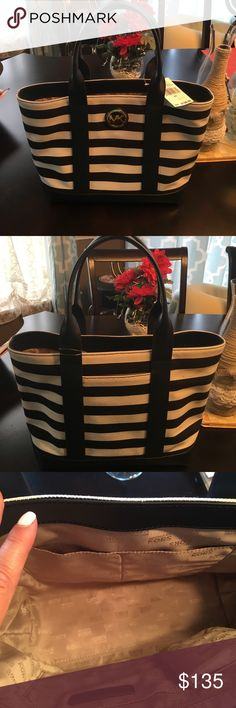 NWT! Michael Kors purse NWT! Navy and white striped canvas Michael Kors purse. Perfect summer accessory! Michael Kors Bags
