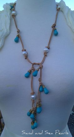 Love this!!! This Necklace is about 36 long. The creamy white freshwater pearls are about 10mm and are knotted on this awesomenatural leather. I