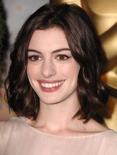 Anne Hathaway's off-center part works for many women. Get her natural- looking