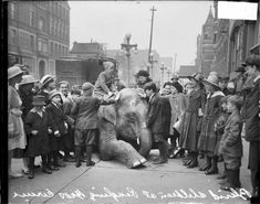 Children playing with an elephant from the Ringling Brothers Circus on April 20, 1917. Photograph from the Chicago Daily News.