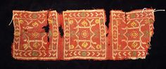 . COPTIC TEXTILE. Egypt, Christian Period, c. 4th-6th century AD. The fabric with three red rectangular ornaments. 3 x 9 inches.