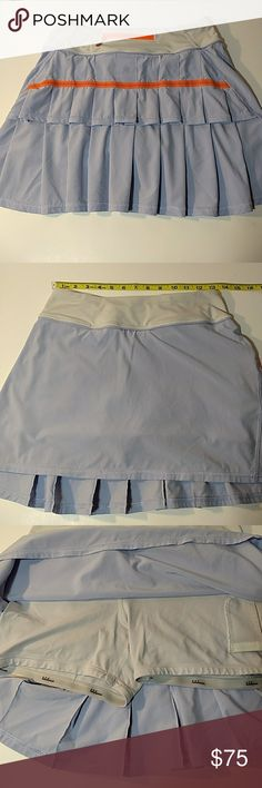 Lululemon Pacesetter Skirt Light lavender pacesetter skirt with orange accents. Good used condition. Shorts underneath with no slip grip to help prevent the legs from riding up. lululemon athletica Skirts