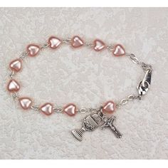 """Catholic Girl's First Communion Rosary Bracelet - Elegant Pink Heart First Holy Communion Rosary Bracelet with 6x6mm Pink Heart Beads and Rhodium Plated Chalice Charm and  Crucifix. This Beautiful Catholic Jewelry comes Packaged in a White Leather Gift Box to Compliment this Special Occasion. The Bracelet Measures 6 1/2"""" in Length Making it an Ideal Bracelet for a Young Girl. -- Find out more about the great product at the image link."""