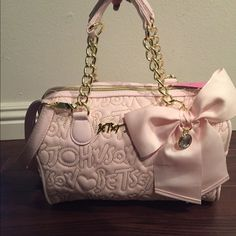 """Betsey Johnson Blush Medium Satchel Beautiful blush BJ purse with gold hardware. Gold stitching of """"Betsey Johnson"""" in bubble letters throughout bag. Bow on front with jewel center. Betsey Johnson logo in gold on front. Can be held by the two chain handles as shown or by the adjustable strap on shoulder or crossbody. Beautiful purse for gift or to wear all day. Pink is so in! Betsey Johnson Bags Satchels"""