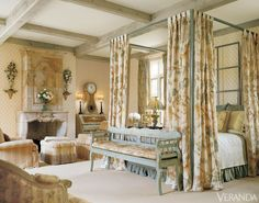 Fine fabrics and antique furniture define this bedroom. Crewel bed hangings from Chelsea Editions. Ann Gish bed from T.A. Lorton, Tracy Salisbury's shop. Antique Swedish bench, secretary and clock. Bennison fabric on bench. Club chairs and ottoman in Bennison fabrics. Zoffany wallpaper. Louis XV limestone mantel. Bedroom draperies in Ralph Lauren fabric. INTERIOR DESIGN BY CHARLES FAUDREE