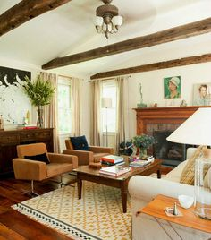 layout of this room - you don't need a lot of space in between everything.  the layering of pieces adds to the warmth of the room...