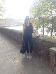 Jumpsuit THE KOOPLES, T-shirt ZARA, sneakers VANS, sunglasses MIU MIU.