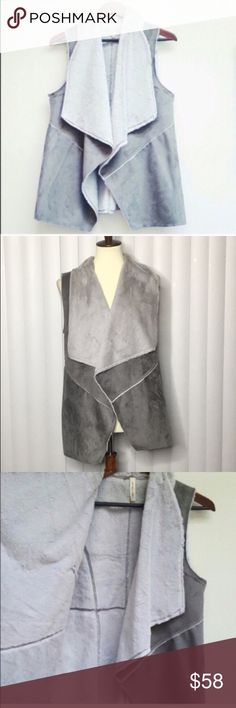 Buttery soft faux vest Soft grey vest lined with faux white fur. Absolutely gorgeous and very very soft. A must have for this fall and winter trends. This is great layering piece.💙 Jackets & Coats Vests