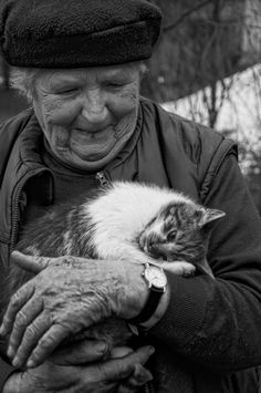 Sebastian Bastex (xbastex on deviantART). Friendship. Old woman and cat.