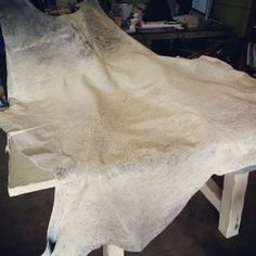 White Silver Metallic Cowhide Rug imported from Argentina. FIND these and more in Houston TX (713)880 2105
