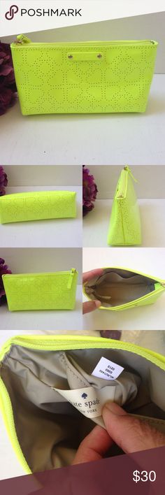 """Kate Spade Metro Spade Little Shiloh Clutch NWOT authentic Kate Spade Metro Spade Little Shiloh Cosmetic Bag/clutch in electric green/yellow. Perforated spades dot a hot colored patent pvc bag with a tan nylon inner. Pocket inside, and zip close. Approx meas:  4""""H x 7.5""""L x 2.5""""W. Style #WLRU1443 kate spade Bags"""
