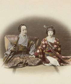 Senior official with his wife.  Hand-colored photo. About 1870, Japan, by photography Felice Beato.  National Museum in Berlin