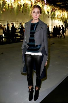 Olivia Palermo wears an asymmetrical Dior coat with a striped sweater, black leather pants and black booties.