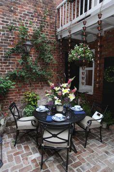 Cozy brick patio with espaliered wall