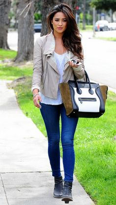 white tee + tan leather jacket + medium wash jeans + multicolor bag + black boots