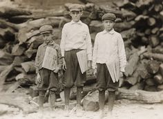 CHILD LABOR: 3 brothers - Newspaper boys  Hine, Lewis Wickes The Davison family, 1312 Tampa Street. William is 14 years old. Been selling newspapers for 9 years. George 12 years. Peter 7 years. Tampa, Florida USA 1913