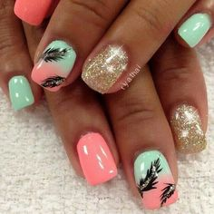 Cute feather accented nails with a beautiful pink coral and mint green with gold glitter.