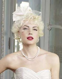 Marilyn Monroe Inspired. Not crazy about the veil piece, but big barrel waves with a birdcage veil would be super classy and totally gorg.