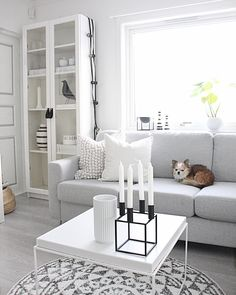 White Ikea 'Billy' bookcase with glass doors @fregnate