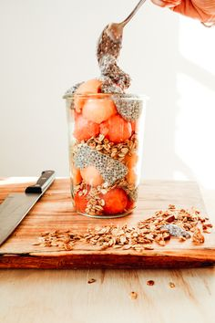 For this parfait, we used cantaloupe and watermelon as the fruit base! We scooped out the fruit with a round spoon and added it to the jar along with some of our favourite Oatbox granola. We added some chia seeds and voila!