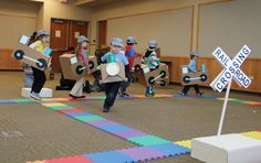 Wild About Trains at the Ela Library--group of kids going around the track