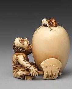 Netsuke of a Man and an Egg. 19th century. Japan. Ivory. The Met.