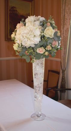Tall flute vases another option for the centre pieces? - Joanne Truby Floral Design