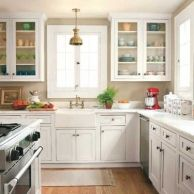 White kitchen, wood floors, pops of color
