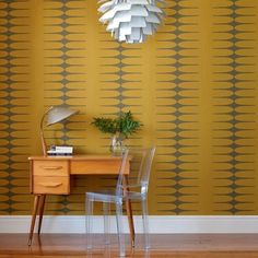 Diggin the vintage wallpaper, and love the mid-century desk!