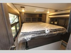 Keystone Raptor toy hauler 427 highlights: Below-Floor Garage Exterior TV King-Size Bed High-Top Table Theater Seating With the unique layout of. Raptor Toys, Fifth Wheel Toy Haulers, Garage Exterior, High Top Tables, Keystone Rv, Theater Seating, King Beds, Countertops, Tall End Tables