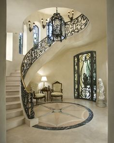 Mediterranean Staircase with Wall sconce, Concrete floors, Custom wrought iron stair railing, Stone Medallions, Arched window Luxury Staircase, Staircase Design, Marble Staircase, Curved Staircase, Railing Design, Wrought Iron Stair Railing, Villa Plan, House Stairs, Stairways