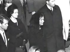 Jaqueline Kennedy watches as JFK's casket is carried to the U.S. Capitol Rotunda, on Sunday, 11/24/63.  To the right is Clint Hill.