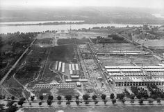 The Lincoln Memorial under construction, with the Potomac in the background, and several Navy and Munitions Buildings in the foreground, on Constitution Avenue, circa 1919.