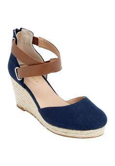 This pretty sandal featuring a leather-like crisscross strap with elastic is sure to make you stand out from the crowd!