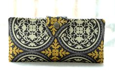 Handmade wallet in gold, gray and white medallions. Cute!