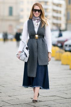 A denim skirt paired with a belted scarf.