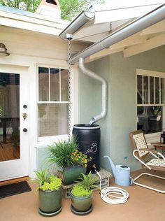 Eco-Friendly Outdoor Patio: Gutters on this Longwood, Florida, home direct runoff into a rain barrel. A hose connected to the rain barrel makes it easy to hand-water a few pots nearby. A rain chain also guides water from the roof into a large pot.