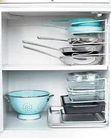 Stack pans instead of nesting them. Turn a vertical bakeware organizer on its end and secure it to the cabinet wall with cable clips.