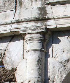 Tuscan order capital on an engaged column: Amphitheater at Capua in the province of Caserta, Campania, southern Italy