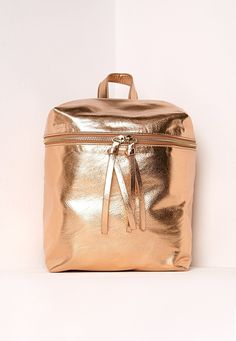 A zip top backpack that goes for the rose gold.