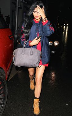 Rainy Day Style from Kylie Jenner's Street Style.  She fights off the rainy weather with a super glossy blowout and an enviable navy-and-red ensemble.