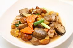 Stir-fry of straw mushrooms, carrots, green scallion, ginger, savory chestnuts and slices of lean pork.