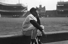 1957. Willie Mays sits in the dugout at the old Polo Grounds during the Giants last season in New York before heading out West to San Francisco.