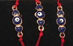 Red String Blue Hearts of Love Evil Eye Bracelet Ward away the evil spirits- give to someone who needs luck, protection or a great Bat Mitzvah Gift! Adjustable macramé knot back-one size fits all! http://www.bettinascollection.com/products/red-string-blue-hearts-of-love-evil-eye-bracelet