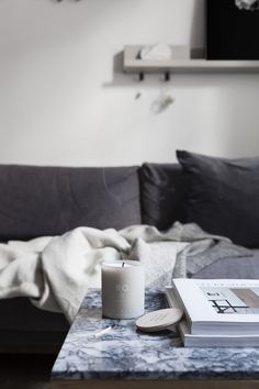 Skandinavisk Ro scented candle in the living room of Coco Lapine