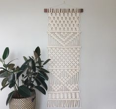 macrame wall hanging made out of 100% cotton rope and locally sourced walnut #macrame #woven #wallhanging #wall #hanging #weaving #cream #white #hollymuellerhome