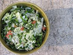 The famous Veggie Salad - w/cabbage, spinach, parsley, tomatoes, scallions, cottage cheese & dressing