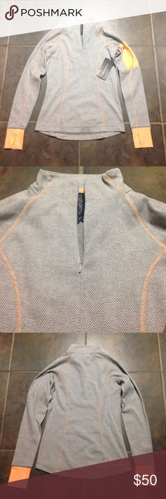 Beautiful grey  herringbone top. NWT Beautiful grey and orange chevron top. Half zip top, small zipper on left sleeve, thumb holes. NWT **Not Lululemon!!** lululemon athletica Tops